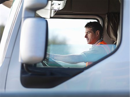 side view tractor trailer truck - Truck driver in truck cab Stock Photo - Premium Royalty-Free, Code: 649-03773435