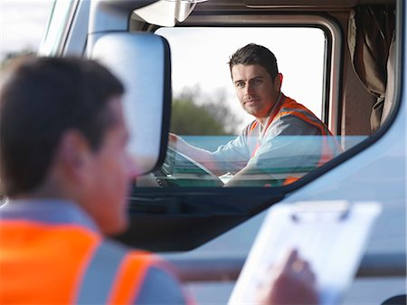 side view tractor trailer truck - Truck driver with worker taking notes Stock Photo - Premium Royalty-Free, Code: 649-03773436