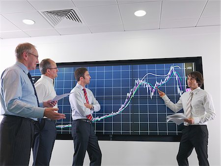 Business meeting with graphs on screen Stock Photo - Premium Royalty-Free, Code: 649-03773544