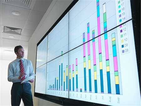 Businessman with graphs on screen Stock Photo - Premium Royalty-Free, Code: 649-03773548