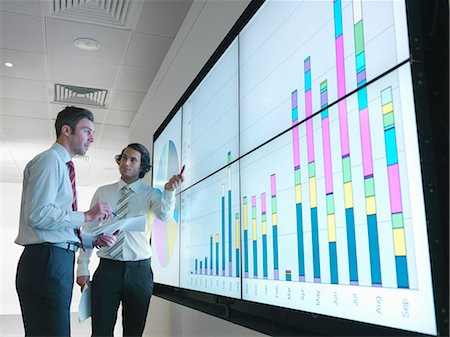 Businessmen with graphs on screen Stock Photo - Premium Royalty-Free, Code: 649-03773549