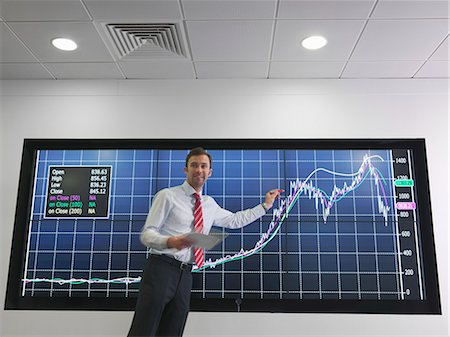 Businessman with graph on screen Stock Photo - Premium Royalty-Free, Code: 649-03773540