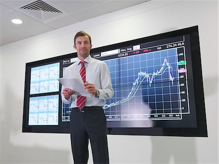 Businessman with graph on screen Stock Photo - Premium Royalty-Free, Code: 649-03773542