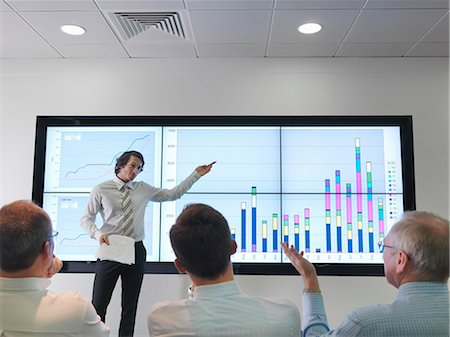 Business meeting with graphs on screen Stock Photo - Premium Royalty-Free, Code: 649-03773543