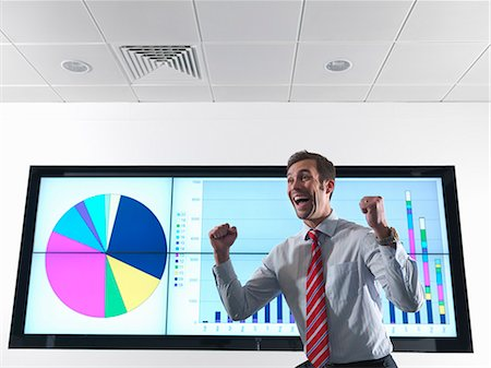 Successful businessman with graph Stock Photo - Premium Royalty-Free, Code: 649-03773555