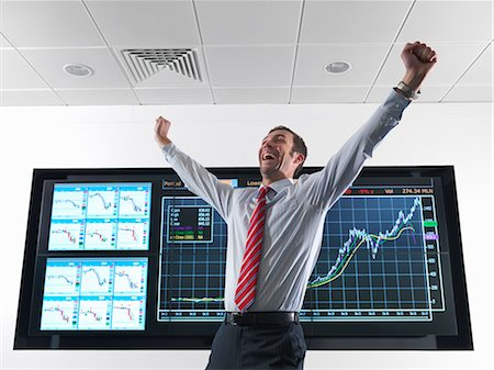 Successful businessman with graphs Stock Photo - Premium Royalty-Free, Code: 649-03773556