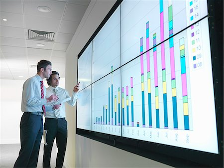 Businessmen with graphs on screen Stock Photo - Premium Royalty-Free, Code: 649-03773550