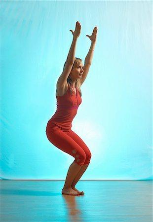 Lady doing yoga in a studio Stock Photo - Premium Royalty-Free, Code: 649-03773794