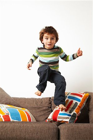 Boy jumping on sofa Stock Photo - Premium Royalty-Free, Code: 649-03796074