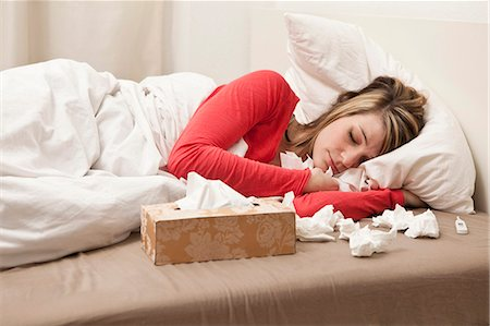 Woman with cold sleeping Stock Photo - Premium Royalty-Free, Code: 649-03797105