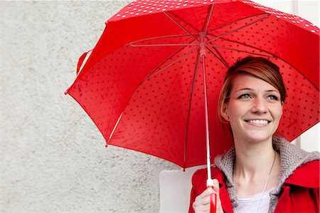 people with umbrellas in the rain - Portrait of woman with umbrella Stock Photo - Premium Royalty-Free, Code: 649-03797130