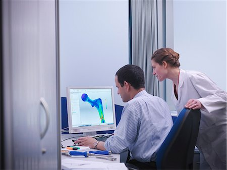 Workers with CAD drawing in office Stock Photo - Premium Royalty-Free, Code: 649-03797233