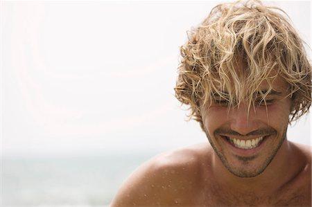 shirtless men - Guy looking down, smiling Stock Photo - Premium Royalty-Free, Code: 649-03797425