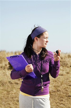 stop watch - Woman holding clipboard and stopwatch Stock Photo - Premium Royalty-Free, Code: 649-03816949
