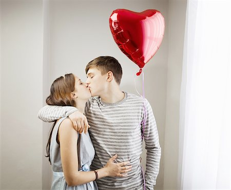 Couple kissing,holding heart balloon Stock Photo - Premium Royalty-Free, Code: 649-03817208