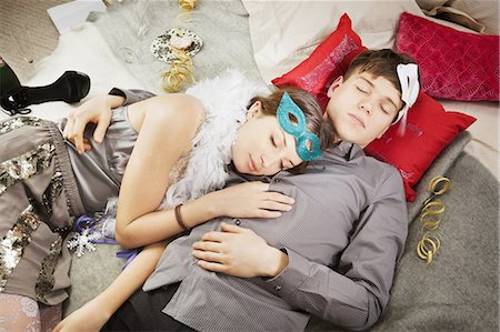 Couple sleeping after party Stock Photo - Premium Royalty-Free, Code: 649-03817214