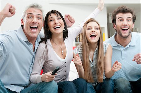 Excited friends watching sport on TV Stock Photo - Premium Royalty-Free, Code: 649-03817381