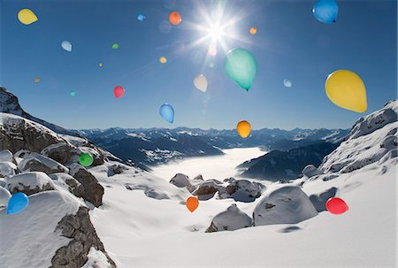Ballons flying over winter landscape Stock Photo - Premium Royalty-Free, Code: 649-03817448