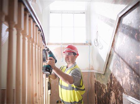 drilling - Builder renovating staircase Stock Photo - Premium Royalty-Free, Code: 649-03817829