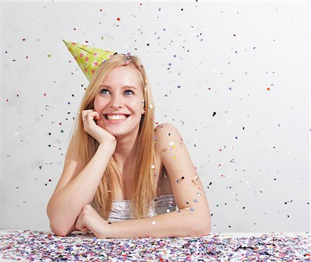 Woman with funny hat and confetti Stock Photo - Premium Royalty-Free, Code: 649-03818044