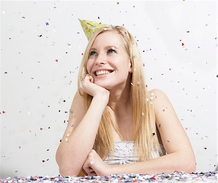 Woman with funny hat and confetti Stock Photo - Premium Royalty-Free, Code: 649-03818045