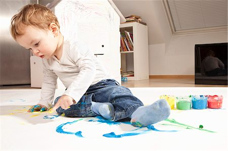 finger painting - Boy playing with finger paint Stock Photo - Premium Royalty-Free, Code: 649-03818287