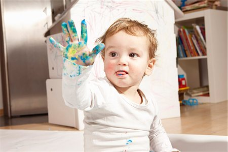 finger painting - Boys hand covered with finger paint Stock Photo - Premium Royalty-Free, Code: 649-03818288