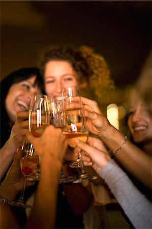 People toasting at party at night Stock Photo - Premium Royalty-Free, Code: 649-03857294
