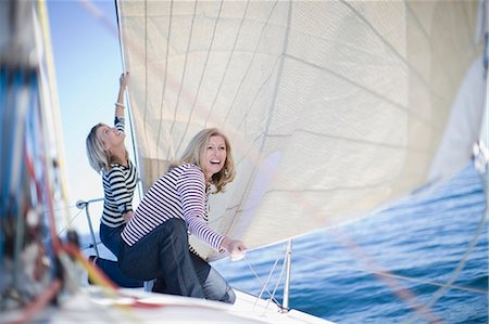 Women adjusting sail on boat Stock Photo - Premium Royalty-Free, Code: 649-03857326