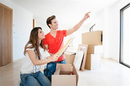showing - Couple unpacking box in new home Stock Photo - Premium Royalty-Free, Code: 649-03857352