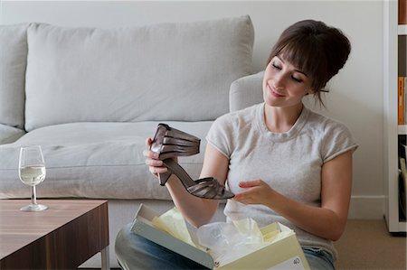 Woman admiring new shoe Stock Photo - Premium Royalty-Free, Code: 649-03857413