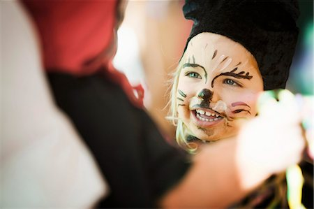 Girl wearing face paint at carnival Stock Photo - Premium Royalty-Free, Code: 649-03857574