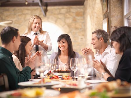 People celebrating in restaurant Stock Photo - Premium Royalty-Free, Code: 649-03858178