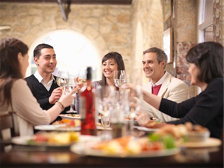 family table eating together - People celebrating in restaurant Stock Photo - Premium Royalty-Free, Code: 649-03858172