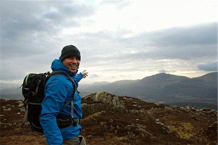 Hiking man admiring mountain view Stock Photo - Premium Royalty-Free, Code: 649-03858411
