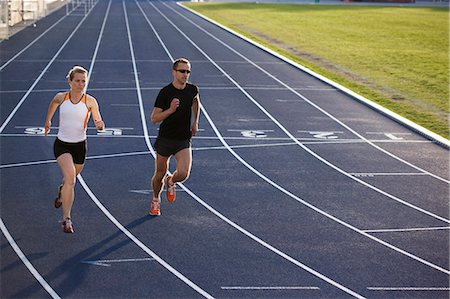 race track (people) - Runners racing on track Stock Photo - Premium Royalty-Free, Code: 649-03884104