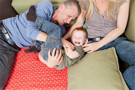 Family playing together on sofa Stock Photo - Premium Royalty-Free, Code: 649-03884185