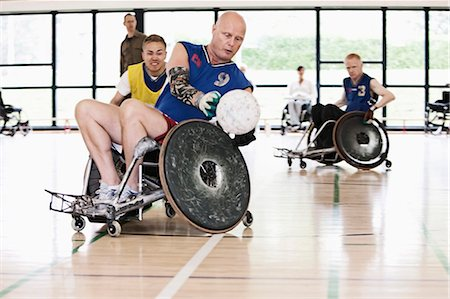 disable exercising - Para rugby players playing rugby Stock Photo - Premium Royalty-Free, Code: 649-03884384