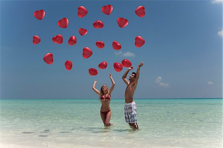 release - Couple playing with balloons on beach Stock Photo - Premium Royalty-Free, Code: 649-03881520