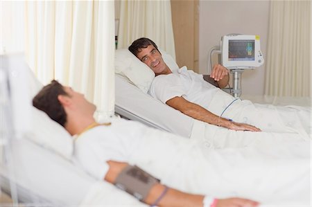 Patients talking in hospital beds Stock Photo - Premium Royalty-Free, Code: 649-03881616