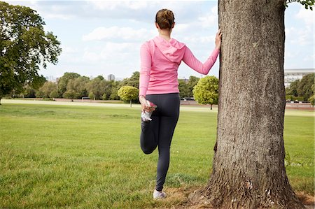 stretching (people exercising) - Woman stretching in park Stock Photo - Premium Royalty-Free, Code: 649-03881901