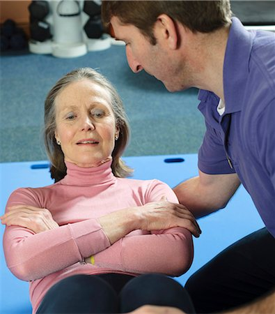 fitness older women gym - Trainer helping older woman exercise Stock Photo - Premium Royalty-Free, Code: 649-03881958
