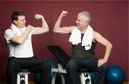 Father and son flexing muscles in gym Stock Photo - Premium Royalty-Free, Code: 649-03882013