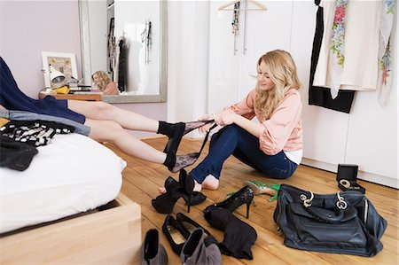 Teenage girl removing friend's tights Stock Photo - Premium Royalty-Free, Code: 649-03882057