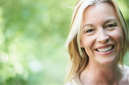Close up of woman smiling Stock Photo - Premium Royalty-Free, Code: 649-03882201