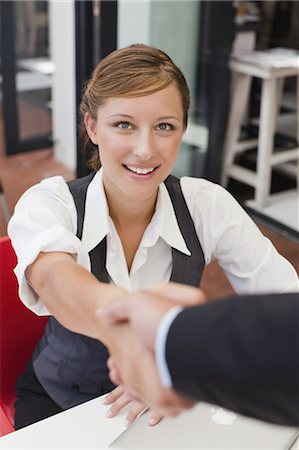 Business people shaking hands at table Stock Photo - Premium Royalty-Free, Code: 649-03882298