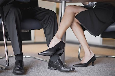 Businesswoman flirting with colleague Stock Photo - Premium Royalty-Free, Code: 649-03882416