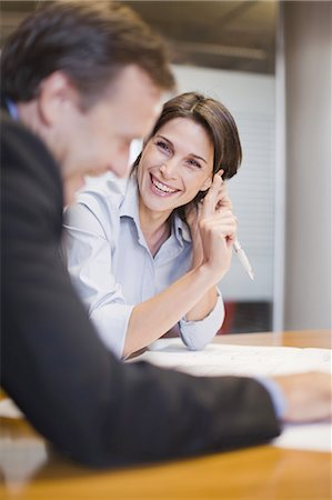 Business people laughing in office Stock Photo - Premium Royalty-Free, Code: 649-03882412
