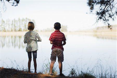 Children standing by lake Stock Photo - Premium Royalty-Free, Code: 649-03882530