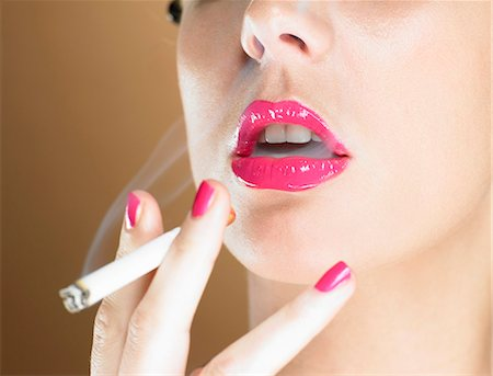 Woman in pink lipstick smoking Stock Photo - Premium Royalty-Free, Code: 649-03883317